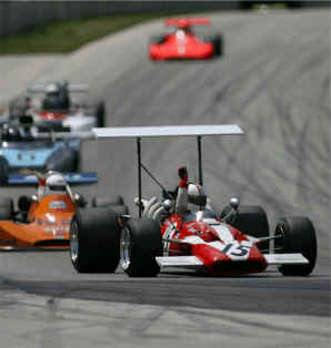 Surtees F/5000 with vintage AP brakes leads the field to the flag at Road America