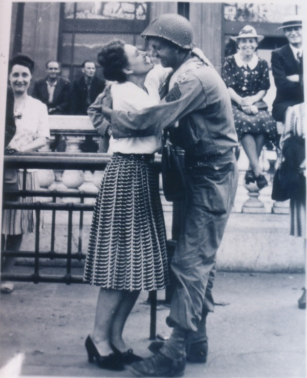 WW2 liberation of Paris aug, 25, 1944, photo from ap newpapers in the us 1944 and US Army paper Yank, 4th ID, 4th Signal, attached to the 12th Army for the liberation of Paris battle of the bulge surrender of germany 1945